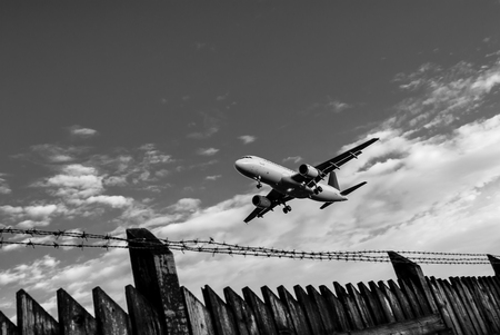 airport fence - black and white image