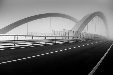 Road bridge in the fog - black and white image 版權商用圖片