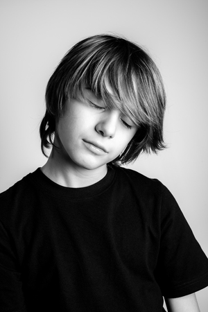 young blonde guy portrait with closed eyes - black and white photo