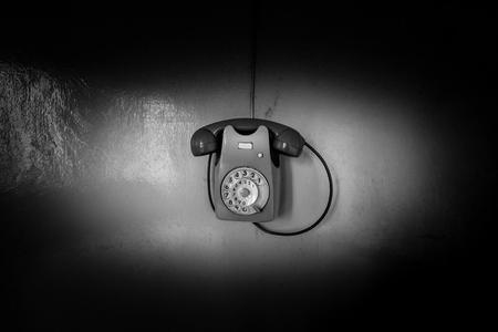 phone on wall - black and white image 版權商用圖片