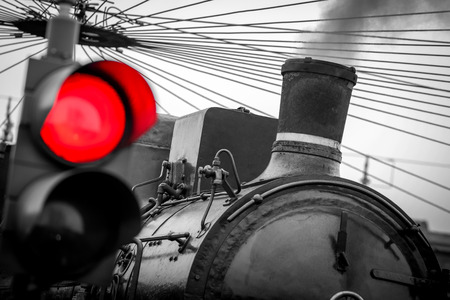 old train with red traffic light - black and white image 版權商用圖片 - 99752880