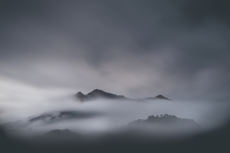 low clouds in mountain landscape - winter mood 版權商用圖片