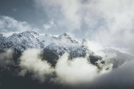 mountain landscape with low clouds - winter mood