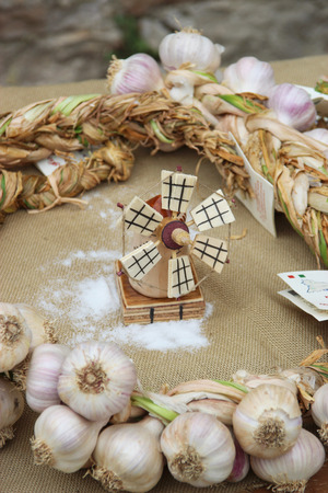 windmill of wood, salt and a crown of garlics photo