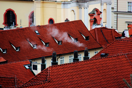 stove pipe: Smoke from roof chimneys Stock Photo