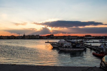 boat at the port at sunset photo