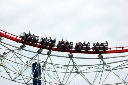 adrenaline rush: Rollercoaster bend with people on Stock Photo
