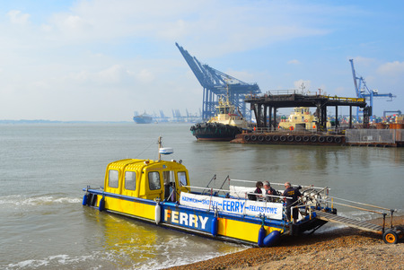 Harwich to Felixstowe and Shotley ferry takes up to twelve people across the busy estuary, port of Felixstowe in background. Editorial