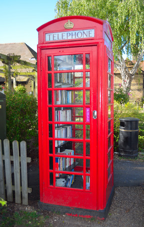 old english: A old traditional English phone box converted into a book exchange - Library. Editorial