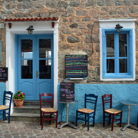 Popular Bar in the harbour area of Molyvos  on a quiet afternoon. Editorial