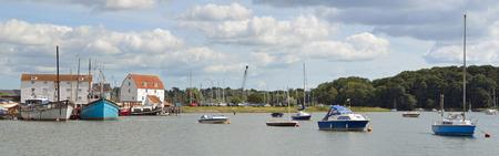 Woodbridge Tide mill dock and boats Suffolk England.