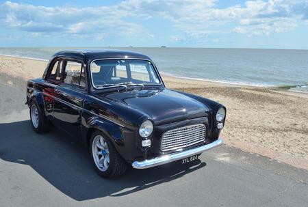 felixstowe: Classic Black Ford Popular in vintage car rally on Felixstowe seafront.