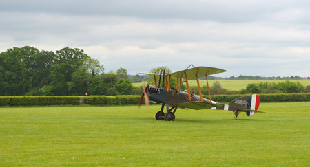 shuttleworth: Royal Aircraft Factory B.E.2s landing on airfield.