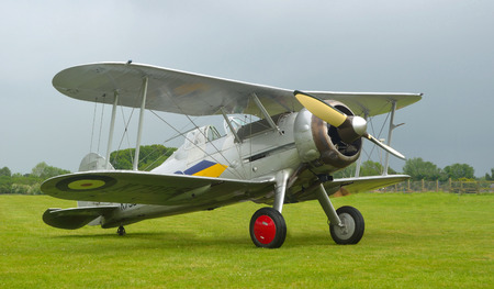 shuttleworth: Gloster Gladiator aircraft outside on airfield Editorial