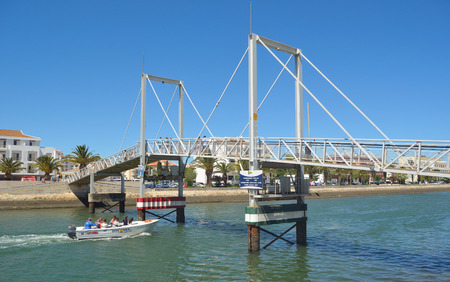 boat lift: The lift bridge at Lagos Marina tourist trip boat going under. Editorial