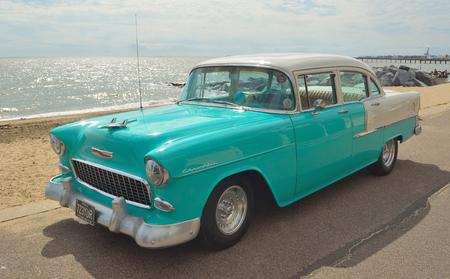 felixstowe: Classic Light Blue and white Chevrolet motorcar on Felixstowe seafront.
