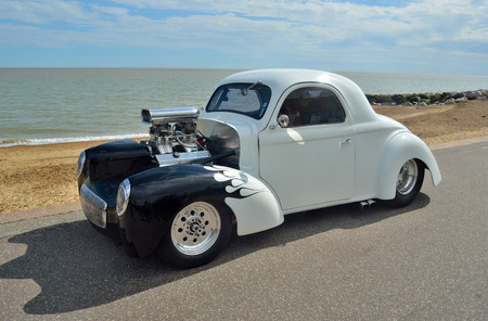 White and Black Hotrod motorcar on Felixstowe seafront. Editorial