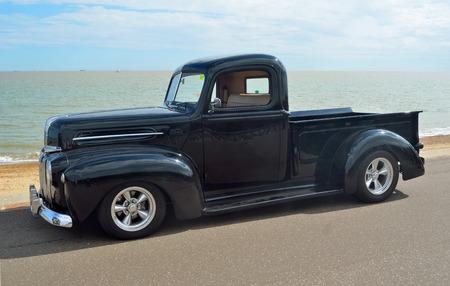 felixstowe: Classic Black Ford pickup truck on Felixstowe seafront.