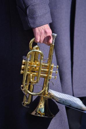 cornet: Cornet in the hand of bandsman.