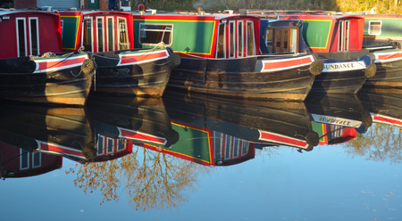 inland waterways: Narrow boats moored at Wrenbury on the Llangollen canal, boats and reflections