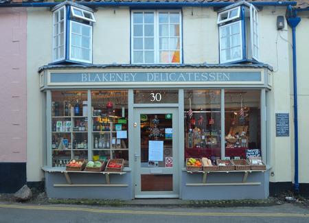 Delicatessen shop front Blakney Norfolk. Editorial