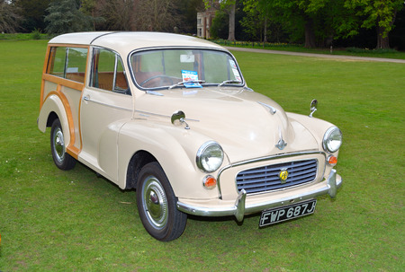 morris: A cream coloured  Classic Morris Traveller motor car.