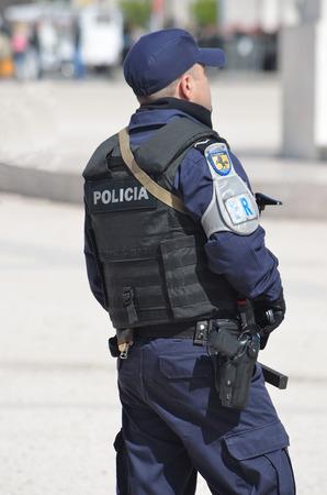 law of portugal: Policeman  on duty at Praca dos Comercio Lisbon Portugal. Editorial