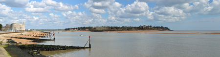 felixstowe: Panorama of the Estuary of the river Deben at Felixstowe Ferry with Martello tower and Bawdsey Manor in the background. Stock Photo