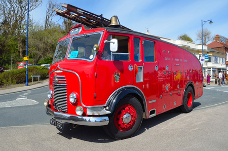 Vintage Commer Fire Engine - Truck parked in road.