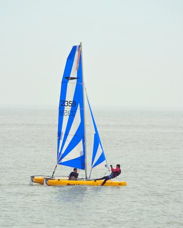 felixstowe: Colorful Dart 16 Catamaran Sailing with 2 crew  at Felixstowe Suffolk England. Editorial
