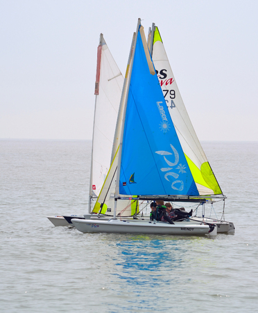 Colourful Sailing Dinghies on the North Sea  at Felixstowe Suffolk England.