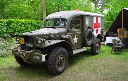 wrest: : World War 2 American Ambulance with Red Cross parked in woods..