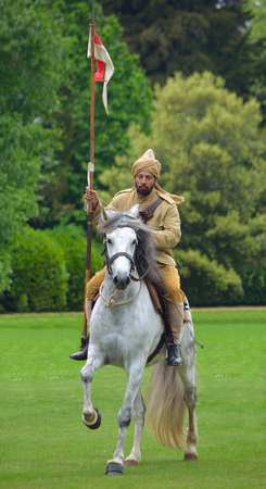 wrest: A member of the Punjab Lancers in World War One uniform riding a white horse.