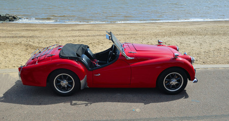 seafronts: Classic Red MGA Open Top Sports car parked on seafront promenade. Editorial