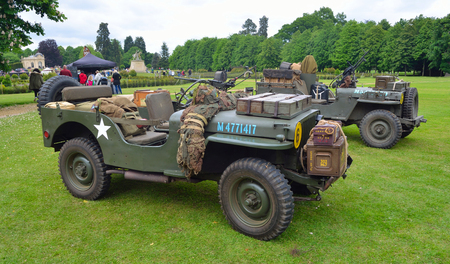 wrest: World War 2 Jeeps with  mounted Machine guns parked on grass.
