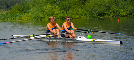 Young men in Pairs Sculling on the river Ouse at St Neots. Editorial