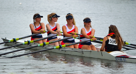 Close up of Female Scullers, Newark Coxed four on the River Ouse at St Neots.