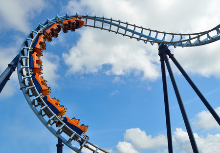 Roller coaster  ride filled  with thrill seekers