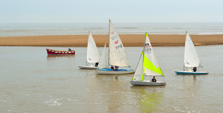 dinghies: Colourful Sailing Dinghies together at the estuary of the river Deben at Felixstowe Ferry Suffolk England.