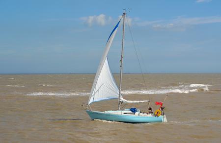 felixstowe: Yacht under sail at the estuary of the river Deben at Felixstowe Ferry.