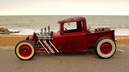 FELIXSTOWE, SUFFOLK, ENGLAND - AUGUST 27, 2016: Classic Hot Rod  pickup truck on seafront promenade with sea in background Editorial