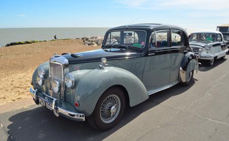 felixstowe: FELIXSTOWE, SUFFOLK, ENGLAND - MAY 01, 2016: Classic Alvis Grey Lady motor car parked on seafront promenade.