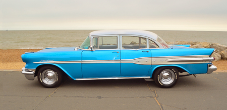 felixstowe: FELIXSTOWE, SUFFOLK, ENGLAND - AUGUST 27, 2016: Classic Blue Pontiac Star Chief Motor Car  parked on seafront promenade.