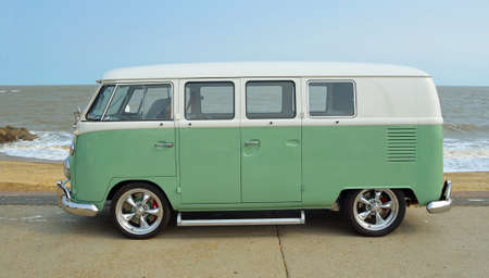 felixstowe: FELIXSTOWE, SUFFOLK, ENGLAND - AUGUST 27, 2016: Classic Green and white  VW Camper Van parked on Seafront Promenade. Editorial