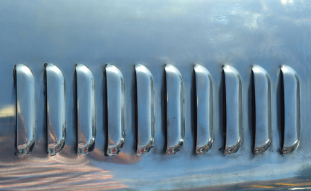 brushed aluminium: Vents in polished stainless steel from car bonnet. Stock Photo