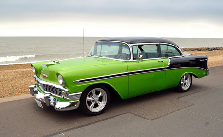 FELIXSTOWE, SUFFOLK, ENGLAND - AUGUST 27, 2016: Classic Green and Black Chevrolet Belair Automobile  parked on seafront promenade. Editorial