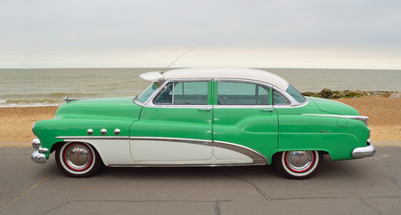 felixstowe: FELIXSTOWE, SUFFOLK, ENGLAND - AUGUST 27, 2016: Classic Green and White Buick Super Eight Moto Car parked on seafront promenade.