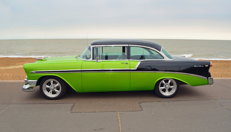 FELIXSTOWE, SUFFOLK, ENGLAND - AUGUST 27, 2016: Classic Green and Black Chevrolet  Belair  American Automobile parked  on seafront promenade. Editorial