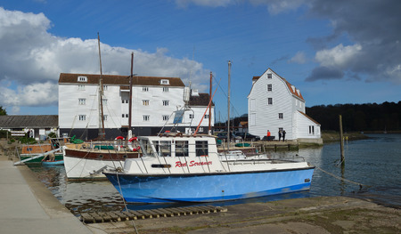 WOODBRIDGE, SUFFOLK, ENGLAND - APRIL 17, 2017: The River Deben at Woodbridge Quay with Tide Mill and Boats.