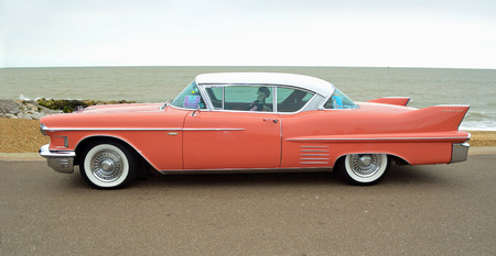 FELIXSTOWE, SUFFOLK, ENGLAND - AUGUST 27, 2016: Classic Pink Cadillac Coupe de Ville  parked on seafront promenade. Editoriali